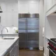 stainless-steel-refrigerator-beside-white-kitchen-cabinet-2343467