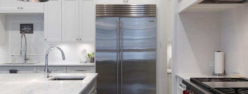 stainless-steel-refrigerator-beside-white-kitchen-cabinet-2343467