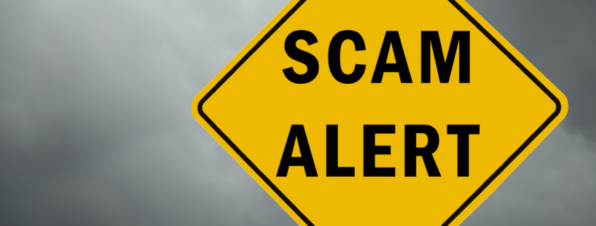 Scam alert conceptual traffic sign and stormy sky
