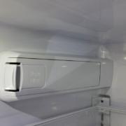 Water filter enclosure inside a refrigerator