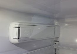 Water filter enclosure inside a refrigerator