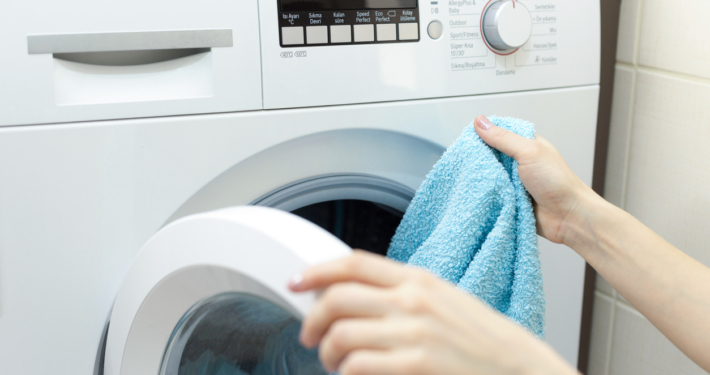 Woman loading laundry
